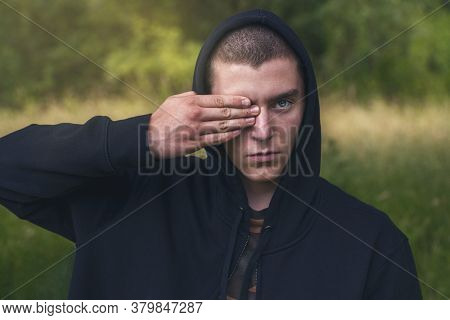 Portrait Of A Young Man With A Black Hoodie Covering His Eyes