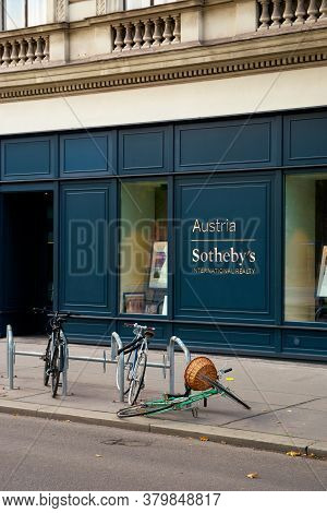 Vienna, Austria - Oct 17, 2019: Fallen Bicycle In Front Of Sotheby's International Realty Building.
