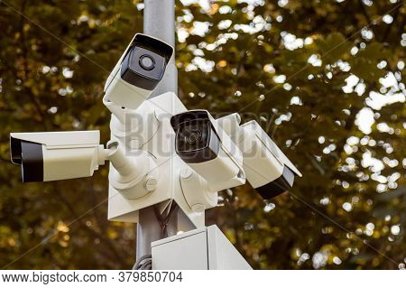 Lamp Post With Lots Of Cctv Cameras. Surveillance And Modern City Security Concept.