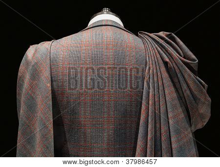 Mannequin in checkered suit with fabric folds