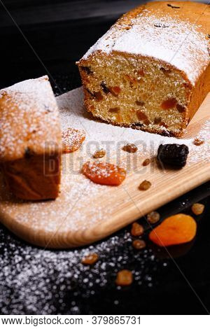 Sweet Cupcake In The Shape Of Bread. Cupcake With Raisins, Dried Apricots, Plums.