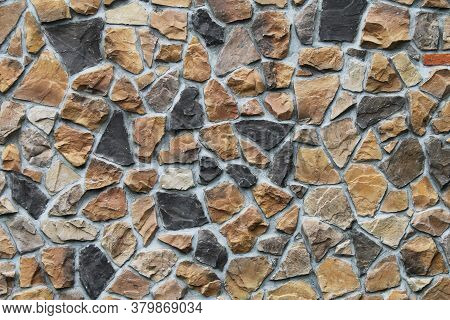Colorful Odd Shaped Tan Black Natural Stone Block Wall With Shadows Detailed Contour Shades Suitable