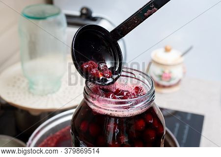 Making Homemade Cherry Jam. Jam Is Poured Into Storage Jars, Selective Focus