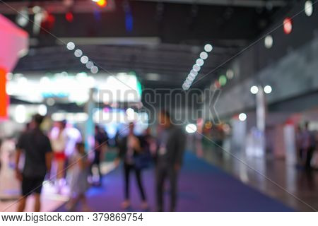 Blurred Crowd Of People Walking Through Building Technology Market Expo Exhibition Event Market In C