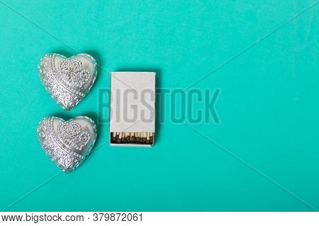 Two Decorative Candles In The Shape Of A Heart. Next To Them Is A Box Of Matches. Love And Togethern