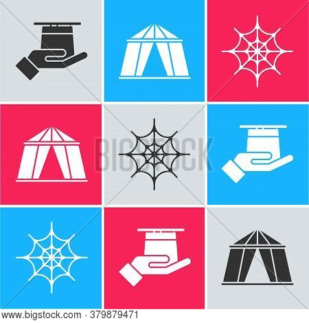 Set Magician Hat In Hand, Circus Tent And Spider Web Icon. Vector