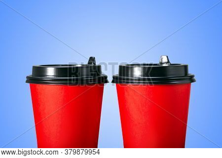 Paper Coffee Cups On Blue Background. Two Coffee Cup To Go.