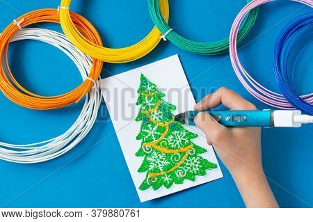 Child Makes Toys For Christmas Tree With 3d Pen. Original Art Project For Children. New Technology.