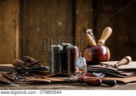 Leather Craft Tools On Old Wood Table. Leather Craft Workshop.