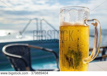 Cold Beer On A Beach In Big Moist Glass
