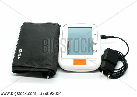 An Electronic Device For Measuring Blood Pressure At Home. Large Display, Automatic Cuff. Mains Powe