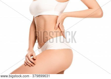 View Of Young Woman In Top And Panties Standing With Hand On Hip Isolated On White