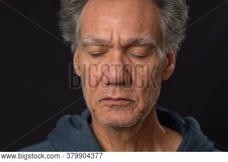 Distraught Not Shaven Senior Man At Home Looking Depressed And Tired Of Being Locked Down.