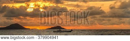 Sunset Over The Islands Of Flores, Near Labuan Bajo, Indonesia, With Boats In The Foreground