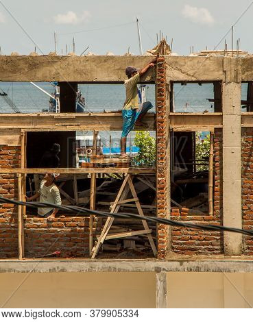 Flores, Indonesia - April 10th 2018: Lack Of Health And Safety In Indonesian Construction Site, Flor