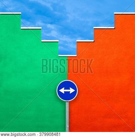 Concept Of Two Colored Walls And A Sign Post, Image Of A Green And An Orange Wall With Blue Sky And