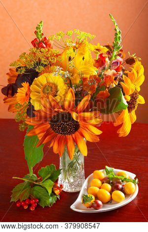 Autumn still life with  bouquet of flowers and berries