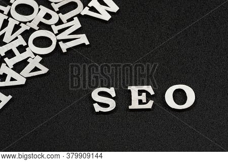 Word Seo Is Composed Of White Letters On Black Background. Website Optimization Concept.