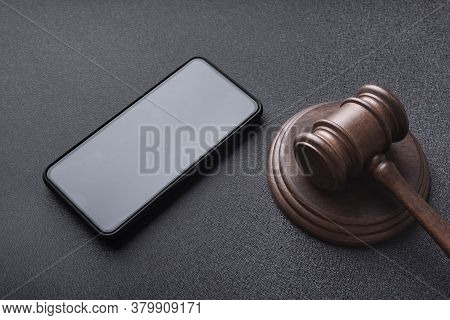 Smartphone And Judges Gavel On Black Background. Copy Space. Template. Mockup.