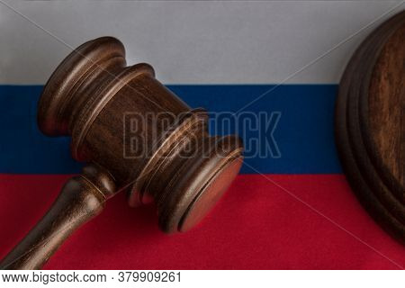 Justice Mallet On Russia Flag Close Up. Law And Justice. Rights Of Citizens.