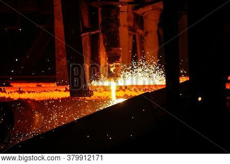 Steel Billets At Torch Cutting In Metallurgical Plant. Metallurgical Production, Heavy Industry, Eng