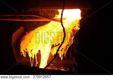 Hot Steel Pouring In Steel Plant. Molten Metal Poured From Ladle. Metallurgical Production, Heavy In
