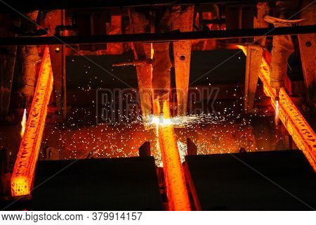 Red Hot Steel Metal Wire Rods Or Coils After Molten Steel Casting.  Continuous Casting Machine. Back