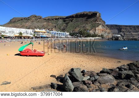 Gran Canaria, Spain - December 2, 2015: People Visit Puerto Mogan Beach In Gran Canaria, Spain. Cana