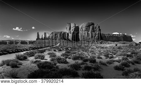 Black And White Photo Of The Three Sisters And Mitchell Mesa, A Few Of The Many Massive Red Sandston