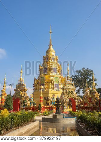 Phayao, Thailand - Dec 31, 2019: Gold Pagoda Or Stupa On Blue Sky Background In Wat Phra Nang Din Or