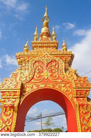Phayao, Thailand - Dec 31, 2019: Front Gold Red Pagoda Or Stupa Entrance Door On Blue Sky Background