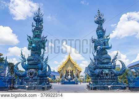 Chiangrai, Thailand - June 7, 2020: Green God And Blue God Hold Lotus And Yellow Blue Thai Church On
