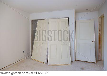 Interior Wooden Stacker Door Installation, Apartment Building, A Wait Installation For Preparation O
