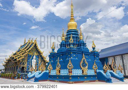 Chiangrai, Thailand - June 7, 2020: Blue Yellow Pagoda And Church Of Wat Rong Suea Ten At Chiangrai