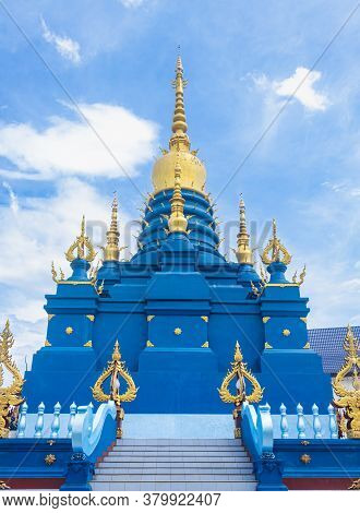 Chiangrai, Thailand - June 7, 2020: Blue Yellow Pagoda Or Stupa On Blue Sky Background In Wat Rong S