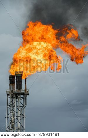 Fire On Flare Stack At Oil And Gas Central Processing Platform While Burning Toxic And Release Over