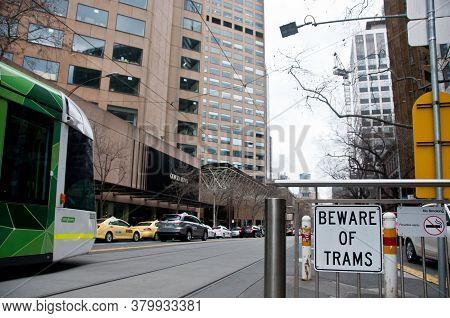 Melbourne, Australia - July 26, 2018: Beware Of Tram Sign With Melbourne Tram In Melbourne Victoria