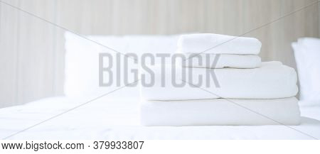 Stack Of White Towel And Bathrobe On Bed In Luxury Hotel Or Resort. Laundry, Relax, Holiday, Spa, Ma