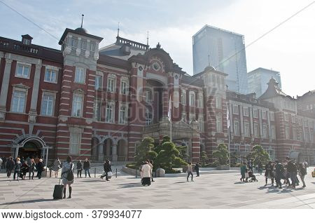 Tokyo, Japan - December 1, 2018:  Tokyo Station Railway Building With Warm Sunlight Shines To Trees