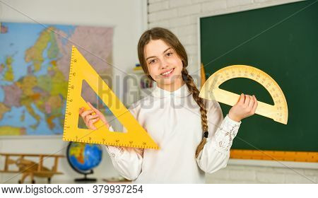 Small Child Holding Ruler For Mathematics Lesson. Mathematics Matters. Cute Little Schoolgirl With G