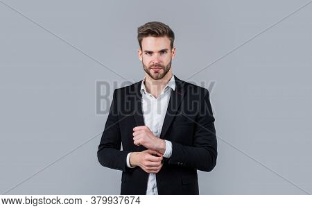 Confident In Style. Portrait Of A Businessman On Grey Background. Confident Businessman Portrait. Po
