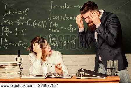 Problem Solving. Bearded Man And Sexy Woman Consider Problem At Lesson. Problem At School. Education
