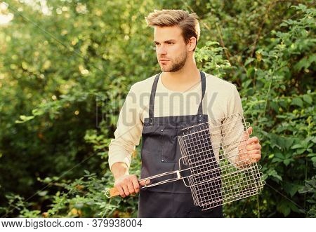 Picnic Concept. Man Hold Grilling Grid. Grilling Food. Backyard Barbeque Party. Handsome Guy Cooking