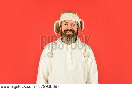 Sheep Fur. Bearded Funny Hipster. Perfect Accessory. Bearded Man Wear Hat With Ear Flaps Red Backgro
