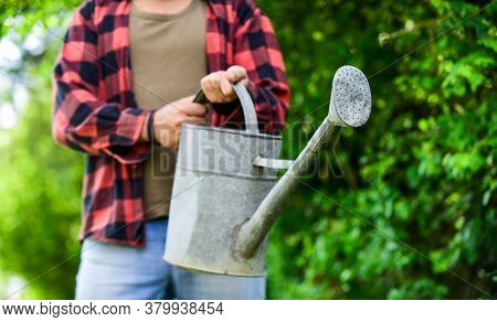 Summer Heat. Equipment In Farmers Hands. Rustic Style. Gardening And Watering Plants. Gardening Conc