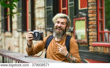 Brutal Stylish Man With Retro Camera. Modern Business. Old Technology. Professional Photographer Use