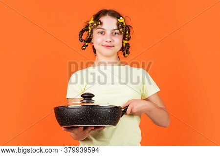 Little Homemaker Holding Pan With Ready Meal. Kid Daily Routine Small Girl Making Domestic Work. Gir