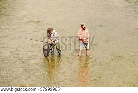 Summer Weekend. Happy Fisherman With Fishing Rod And Net. Hobby And Sport Activity. Male Friendship.