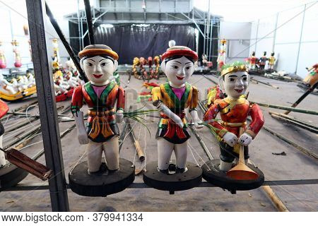 Hoi An, Vietnam, February 24, 2020: Puppets Made Of Fig Tree Wood At The Hoi An Water Puppet Theater