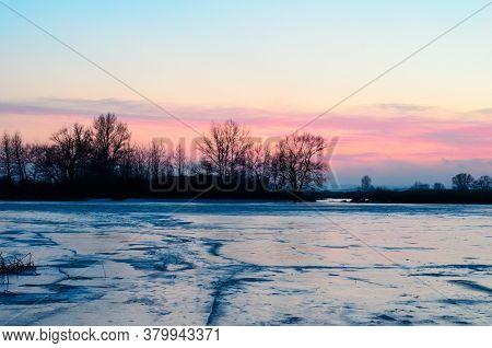 Beautiful Sunset Over The Frozen River Dnieper